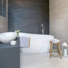 optimise your space with these smart small bathroom ideas ideal home use the same tiles on the floor and ceiling