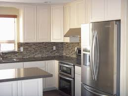 furniture white starmark cabinetry with mosaic tile backsplash