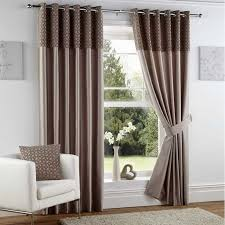 house window with white wall and eyelet faux silk curtains