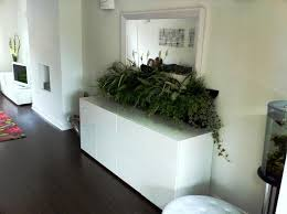 living room indoor living wall planter with grey polyester sofa