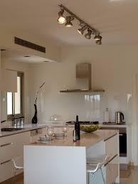 clear glass backsplash kitchen southwestern with braick walls
