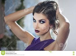 beauty brunette model woman in evening purple dress beautiful