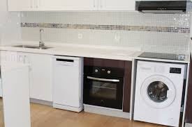 machine a laver dans la cuisine la villa