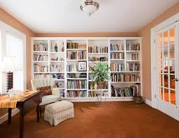 impressive small home library design with wooden flooring and