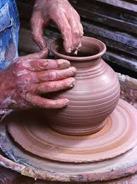 throwing a pot hands throwing a pot on potters wheel clay pottery potter s