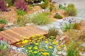 outdoors dreamy backyard idea with small wood garden bridge and