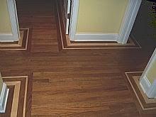 walnut hardwood floor with maple border