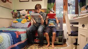 video games addiction brothers boys children with tablet