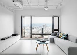 minimalistic apartment clean minimalist apartment with a window overlooking the city