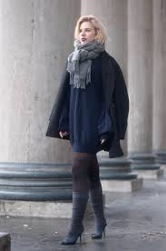 picture of with navy blue mini dress gray boots and black coat