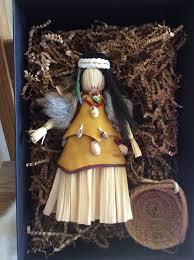 chumash inspired corn husk doll ornament and pine needle basket