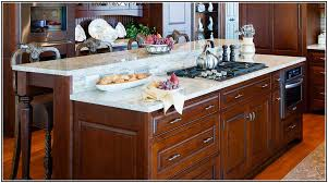 kitchen stove island wooden kitchen island with modern stove top on glossy brown marble