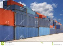stack of cargo containers at container yard with cloud stock photo