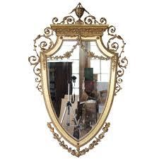 antique english adam style gilt and gesso shield shape mirror