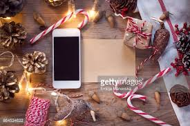 mobile phone with blank screen and ornaments on wooden