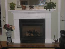 neutral beadboard wooden fireplace mantel mixed animal scultures