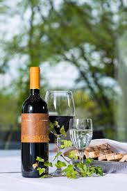 red wine with bottle and glass on a table stock image image