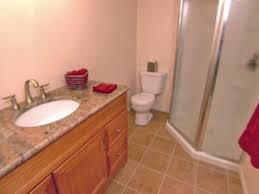 pink wall mosaic tile bathroom floor with brown ceramics floor