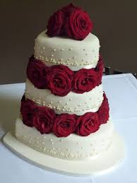heart shaped wedding cakes heart shaped chagne and roses wedding cake bespoke