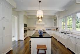 white kitchen with long island kitchens pinterest pricey pads streamlined kitchen with long linear kitchen island