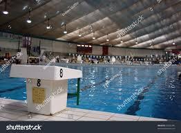 swim race starting block indoor pool stock photo 26502340
