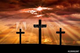 jesus cross on a background with dramatic sky lighting