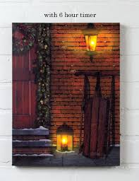 radiance flickering light canvas christmas door with sled lighted christmas picture