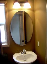 bathroom mirror design oval bathroom mirror on cream wall connected by white sink and