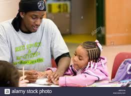 after school study tutor working with preschooler after school study