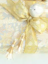 gold gift wrap diy paper tassels gift wrapping inspiration slightly coastal