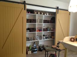 small garage storage ideas design and decor image ofgarage designs full image for brown wood sliding door custom garage storage cabinet design painted with white color