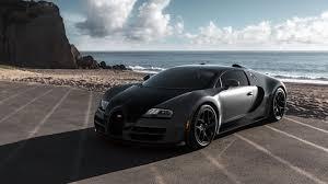 bugatti veyron super sport bugatti veyron super sport vitesse at the beach gray color front