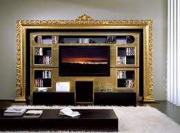 baroque tv wall unit in gold foil for enhancing living area and