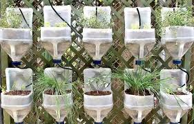 diy self watering herb garden 29 insanely creative diy planter ideas from household items milk