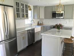 gray kitchen cabinets with lewis dolan brass bar pulls