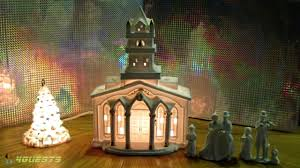 white porcelain lighted church w figurines tree