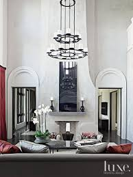 contemporary white living room with double height ceiling luxe