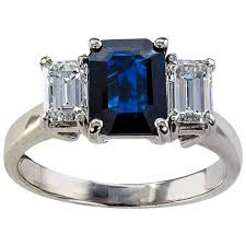 sapphire emerald cut engagement rings emerald cut blue sapphire and three ring at 1stdibs