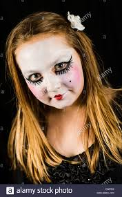 a young with face painted in halloween theme style horror uk