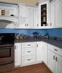 painted blue kitchen walls with white cabinets and cabinetry