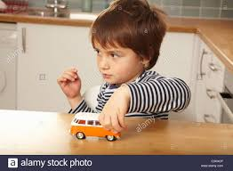 kid play car boy pushing toy car on stock photos u0026 boy pushing toy car on stock