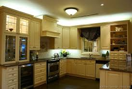 How Black Appliances Look In A Cream Colored Kitchen Traditional - Antique white cabinets kitchen