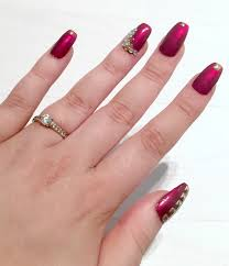 burgundy coffin nails with diamonds and designs nailed it to the