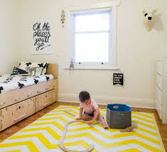 small monochrome boys room with vivid yellow rug 1 kidsomania