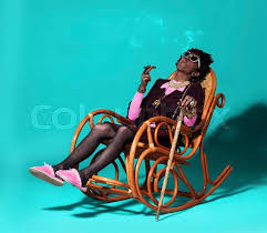 Old Man In Rocking Chair Actor Man Dressed As Old African Woman Lying In Rocking Chair And