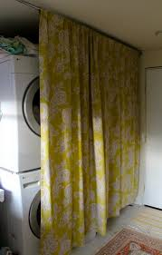 Curtains For Cupboard Doors 15 Laundry Spaces That Cleverly Conceal Their Unsightly Appliances