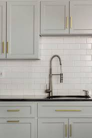 best 25 black countertops ideas on pinterest dark kitchen brass modern cabinet hardware gray cabinets black countertop white subway tile design manifest