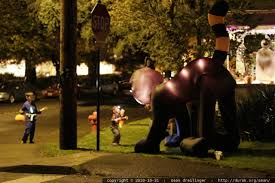 photo entertaining themselves with a giant inflatable halloween