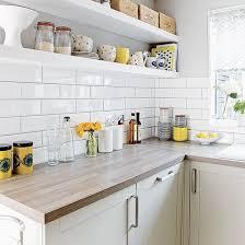 white kitchen with metro tiles and open shelves metro tiles