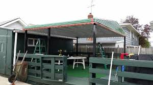 Building An Awning Over A Door Metal And Glass Home Awnings Making A Comeback In The Queens And